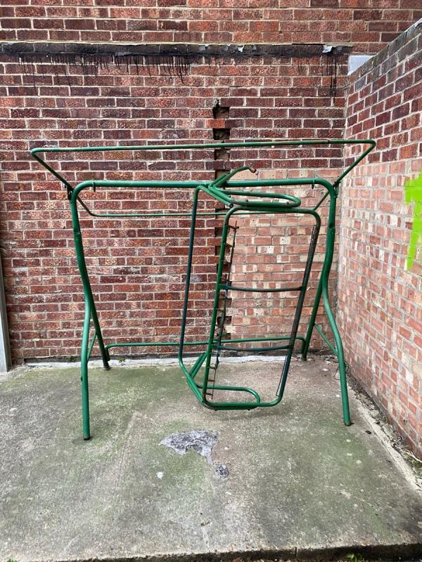 Green frame dumped round the back of chenappa close bins needs picking up been there 5 days -16 Chenappa Close, Plaistow, E13 8DY