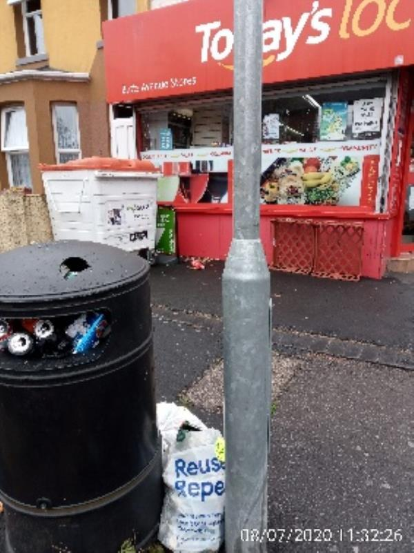 Around the litter bin on Prince of Wales avenue in front of shop have ine please collect -115 Cranbury Road, Reading, RG30 2XB