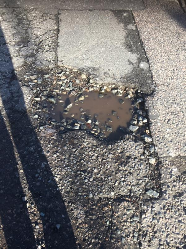 Massive pot hole! Urgent Repair! Please can this repaired!-55 Station Road, Manor Park, E12 5BP