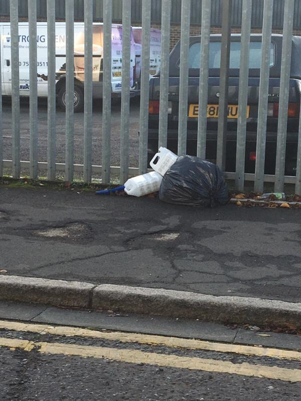 Dumped bag and large plastic bottles-2 Oriental Road, London, E16 2BZ