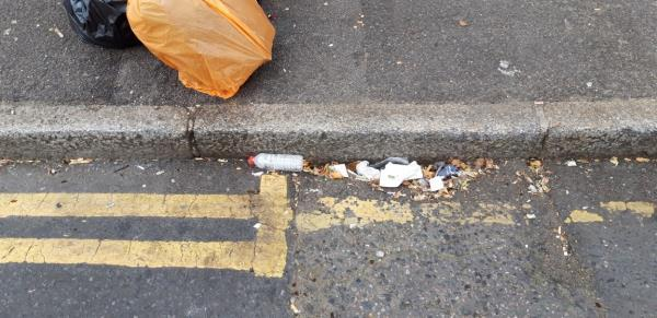 Repeated littering outside side of Bow Cafe-115 Romford Road, London, E15 4LY