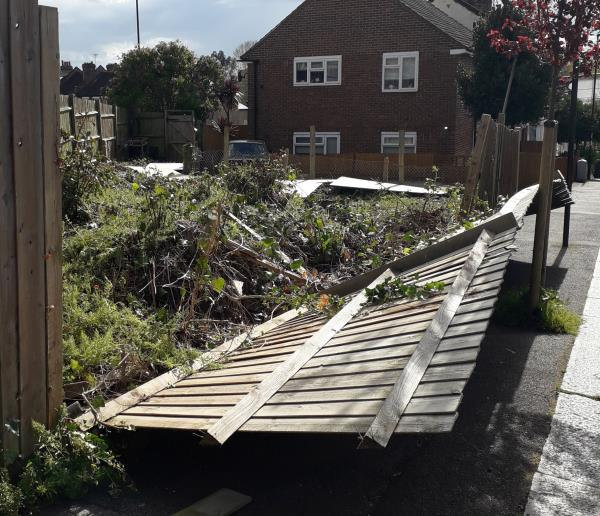 Wind has blown over fence blocking the pavement. This fence and plot of land is owned by the council. Please repair fence or it will turn into a tip again. -66 Harvard Road, London, SE13 6SE