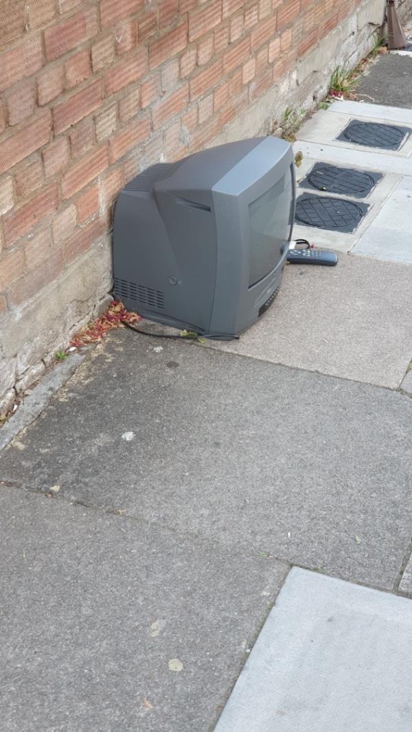 Old TV dumped outside 10 Lascotts Road N22 8JN-12 Lascott's Road, London, N22 8JN