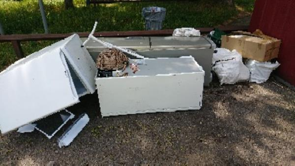 X fridge freezers large amount of household waste fly tipped  image 1-83 Church End Lane, Reading, RG30 4UR