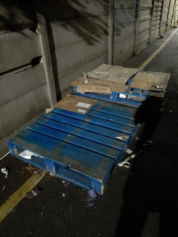 several wooden pallets on lilac Mews-67 High Road, London, N22 6BH