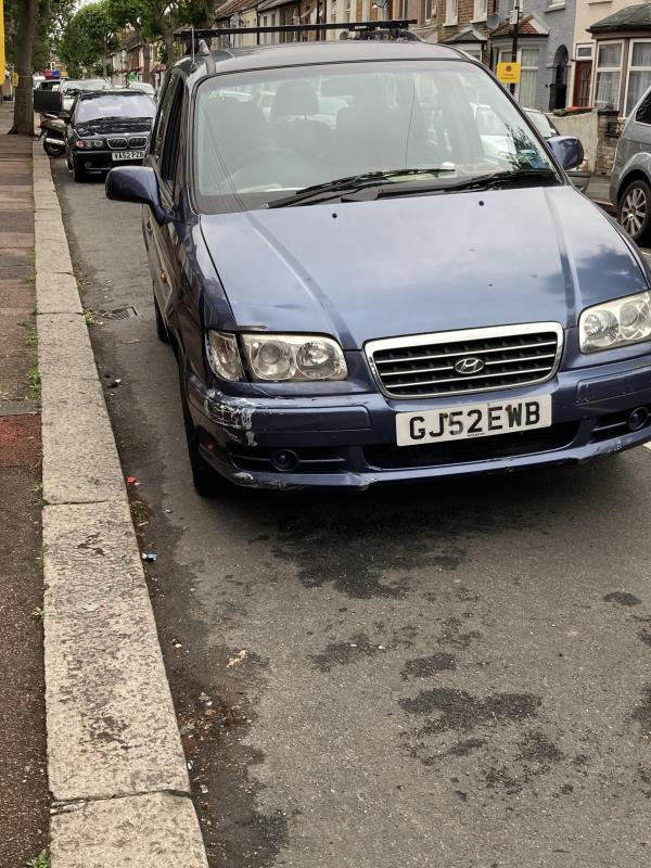 Abandoned car? Windows open, parked crocked, no parking permit. Food containers littered inside. -110 Oakfield Road, East Ham, E6 1LW