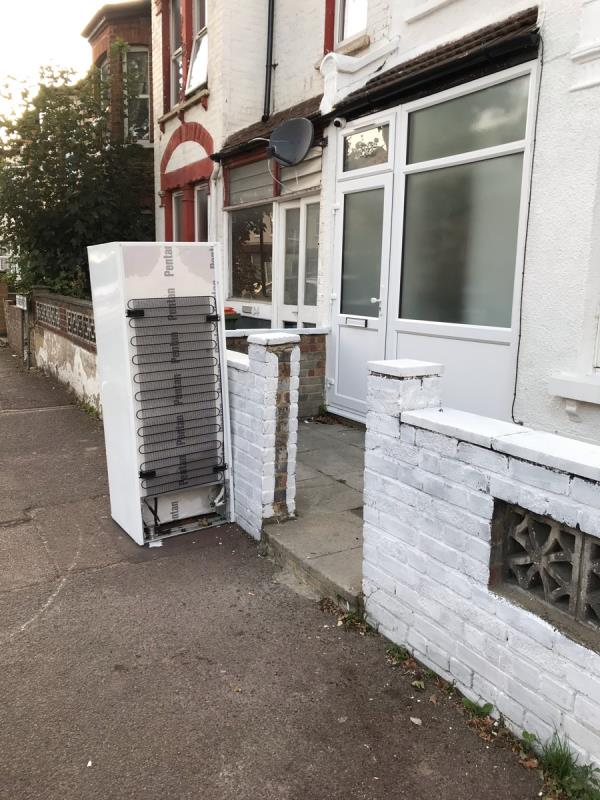 Fly tipped fridge freezer outside 32 Eversleigh Road, East Ham, E6-32 Eversleigh Road, East Ham, E6 1HQ