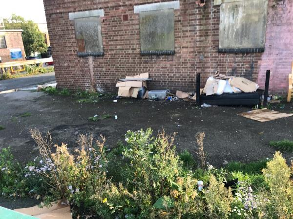 Fly tipped furniture is located within Greenford car park behind Tesco metro -Unnamed Road, Greenford UB6, UK