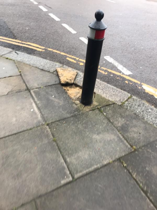 Bollard and pavement are damaged on Ferrymead Gardens junction Goring Way Ub6 -45 Ferrymead Gardens, Greenford, UB6 9NF