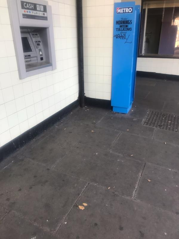 Felt pen tags are located on a Metro newspaper dispenser outside Greenford Tube station entrance -269b Oldfield Ln N, Greenford UB6 8PX, UK