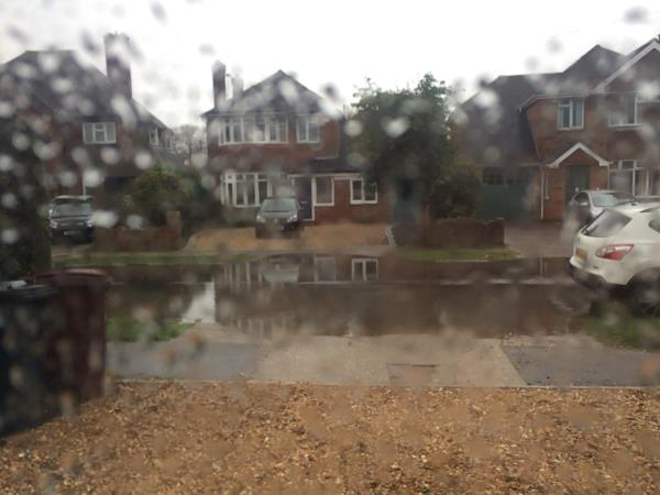 Yet again the whole road width is flooded. The path is partially flooded both sides as well. It stopped raining and the water is not draining away. Cars continue to drive too fast through the water. -48 Stockbridge Gardens, Chichester, PO19 8QT