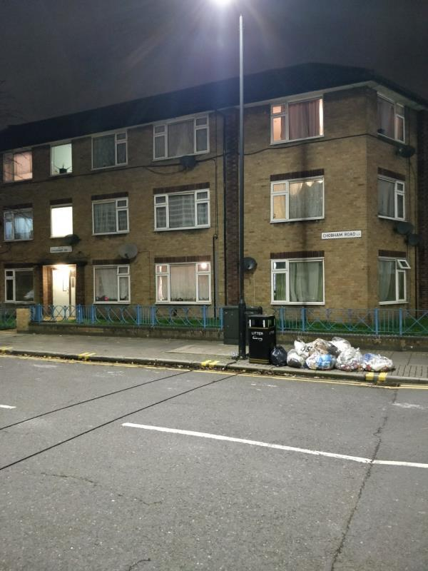 Dumped black bag of rubbish on the pavement beside 2a Chobham Road at the corner of Chobham and Leytonstone Road E15-159a Leytonstone Road, London, E15 1LH