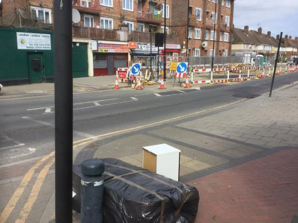 Mattress folded up, outside council block 28-38  image 1-30 Tollgate Road, Canning Town, E16 3LA