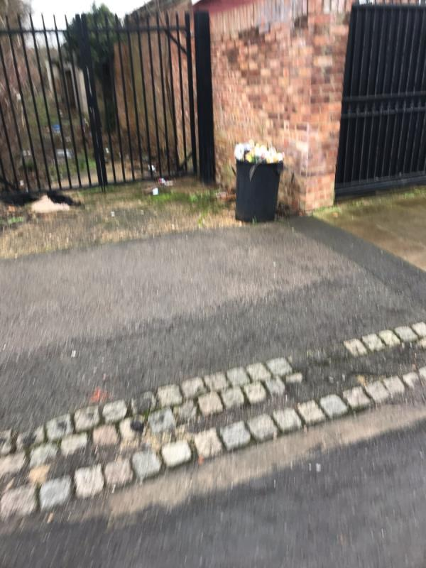 Fly tipped black bin full of litter is located on Ribchester Avenue junction A40 Western Avenue ub6-2 Ribchester Avenue, London, UB6 8TQ