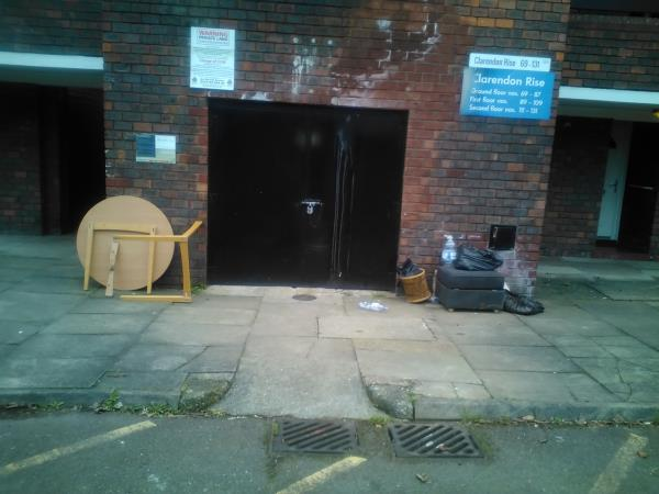 A wooden table, other furniture and black bin bags have been left outside the block of flats 69-131 Clarendon Rise, SE13-135 Clarendon Rise, London, SE13 5EX
