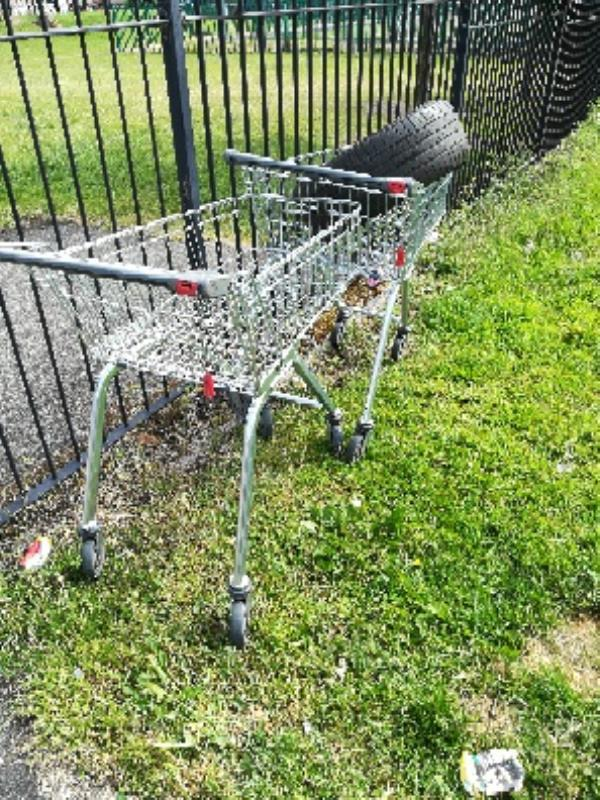 All Saints OS - shopping trolley and tyre dumped at entrance in Gower Street-2 Gower St, Wolverhampton WV2 1DW, UK
