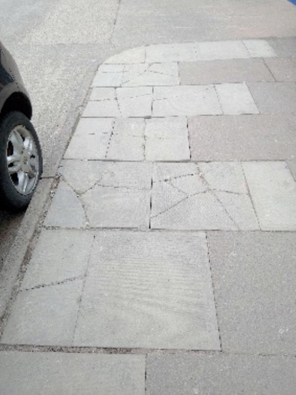 wobbly dangerous slabs outside coral bookies -2 Buckminster Road, Leicester, LE3 9AR