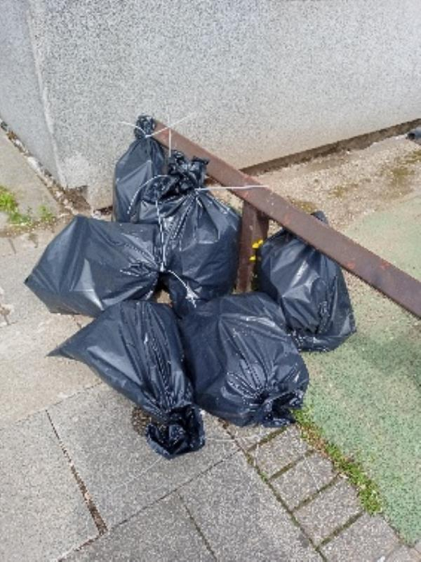 please remove fly tipping front of 203 Wensley Road-322 Wensley Road, Reading, RG1 6ED