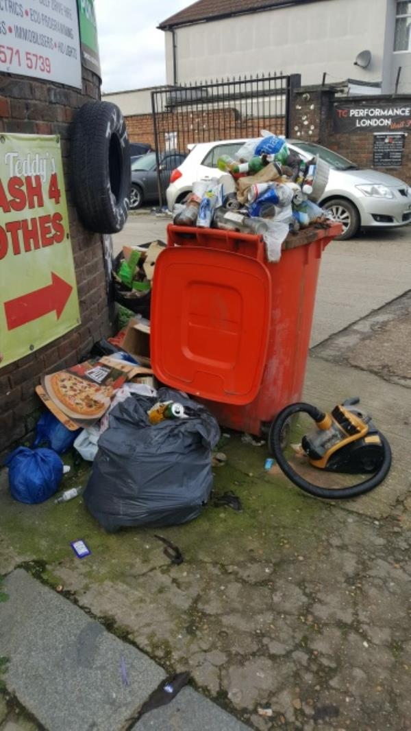 Redundant red 240 bin overflowing with waste and attaching fly tipping-49 Scotts Road, London, UB2 5DD