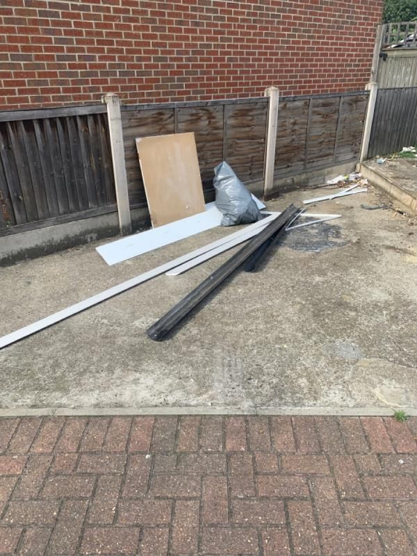 Fly tipping on side of 104 main road -106 Evelyn Denington Road, London, E6 5YU