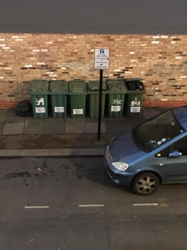 Black bag outside number 1 Waterloo road, bag by bins side of Coffee Hut with overflowing bin also pile of rubbish by lamppost outside Bubble Tea in Plashet Grove-1 Waterloo road E6 1AP