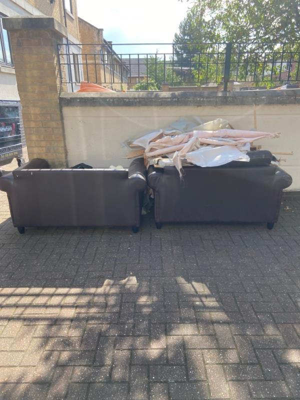 Old armchairs and general building rubbish in the street -Parr House, 12 Beaulieu Avenue, Canning Town, E16 1TS