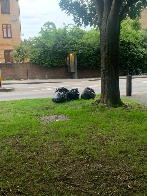 Black bin liners of fly tipped rubbish-180 Tollgate Rd, London E6 5YA, UK