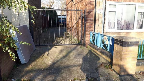 Double mattress fly tipped on the driveway to the rear of 2A-2F Chobham Road E15 (LBN property), presumably from one of the buy-to-let flats in the block.-2c Chobham Road, London, E15 1LU