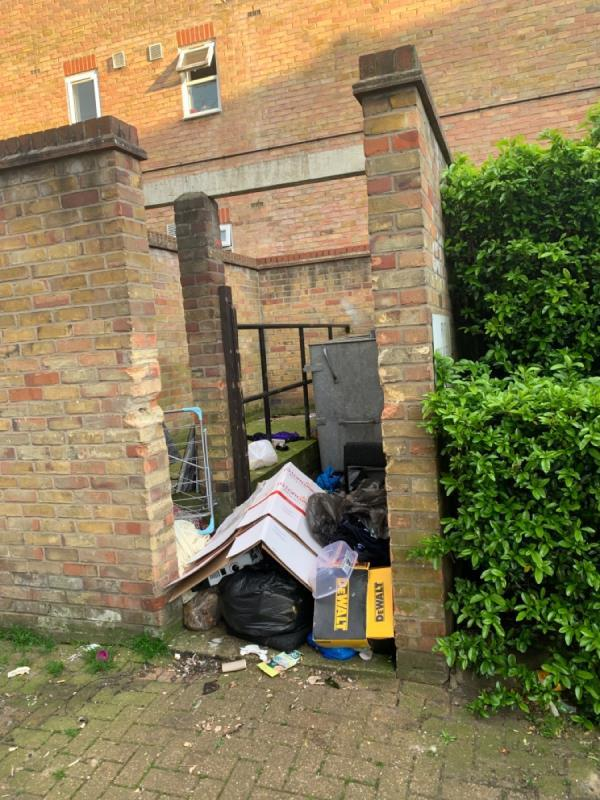 Overflowing bins, piles of bags, rubbish out of bags. Disgusting.-Parkland Court, 2 Maryland Park, London, E15 1HB