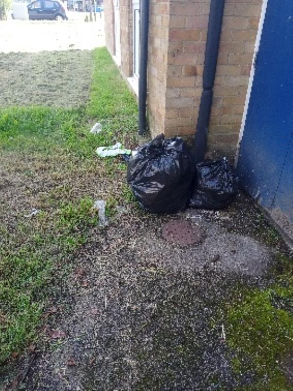 please remove fly tipping in block 19-25 by main entrance-73 Coronation Square, Reading RG30 3QP, UK
