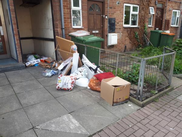 Fly tipped rubbish in front of the bin store between 143/145 Chobham Road. Bins unlawfully left on the carriageway.-143 Chobham Road, London, E15 1LX