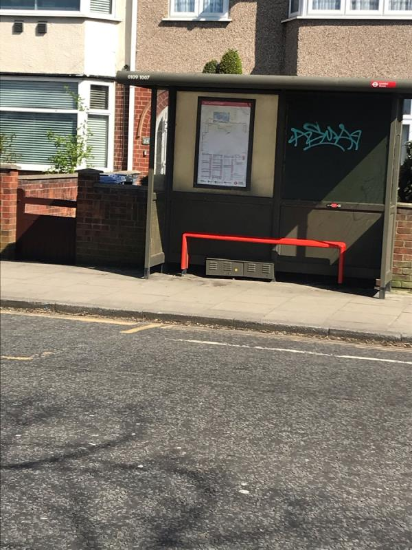 Spray painted tags are located on a bus shelter situated outside 24 Horsenden Lane South ub6 -26 Horsenden Lane South, London, UB6 8AD