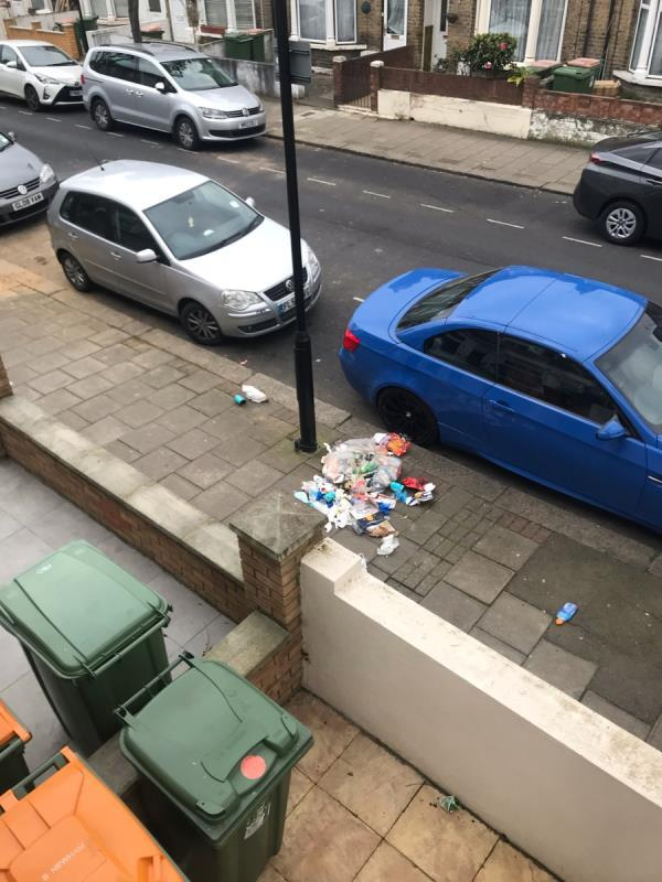 Street cleaners left bag of rubbish, animals have strewn all across pavement -130 Halley Road, London, E7 8DU