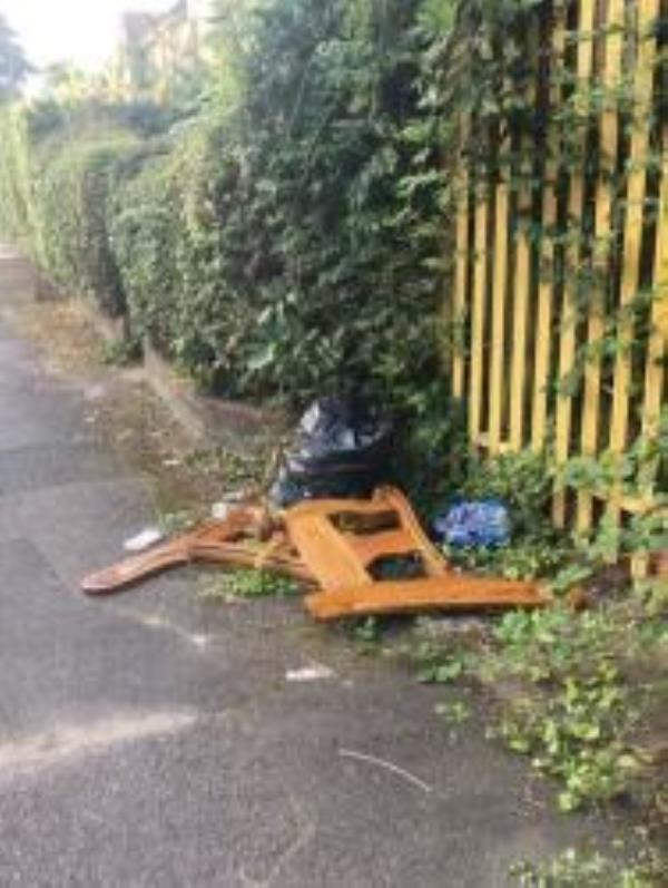 Please clear dumped wood from by yellow fencing. Reported via Fix My Street-72 Milton court road
