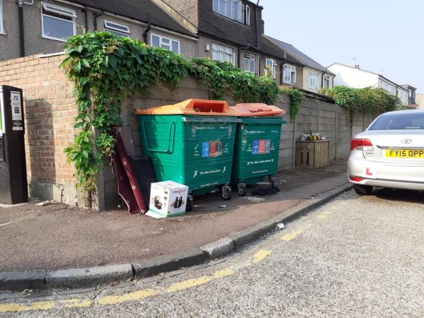 small items by recycling bins that are not recycling also road needs sweeping -10 Globe Road, London, E15 1RF