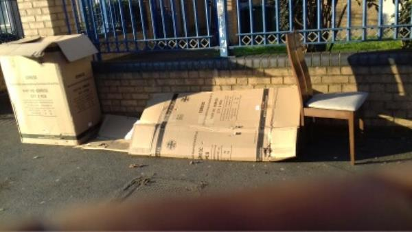 Cardboard boxes and a dining chair dumped outside block 693 to 707 Barking Road -707 Barking Road, London, E13 9EU