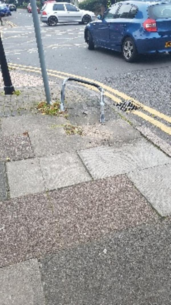 damaged cycle post sharp metal exposed danger to pedestrians and animals outside martin and co estate agents on stuart street -134 Wilberforce Rd, Leicester LE3 0DG, UK