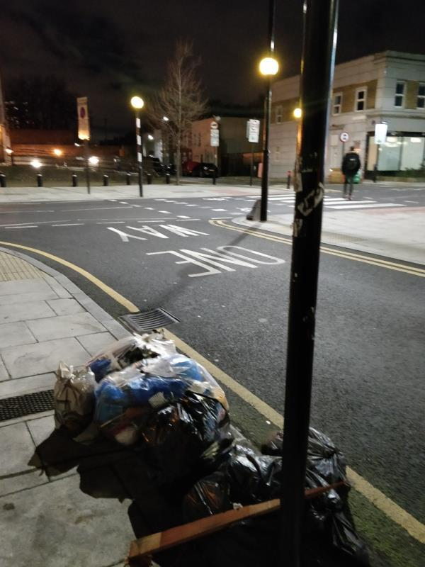 Dumped black bags of rubbish on the pavement beside 60; Leytonstone Road E15-60 Leytonstone Road, London, E15 1SQ