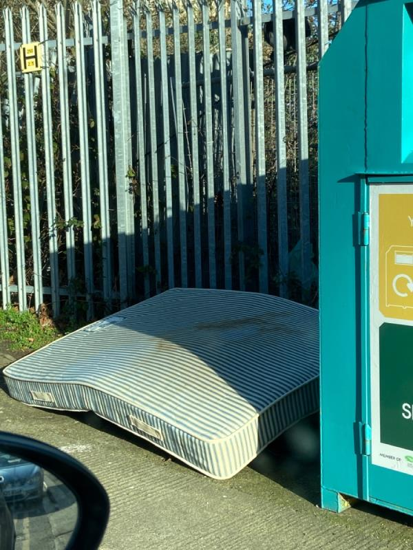 Mattress dumped by recycling point on Rayleigh Road-56 Mill Road, London, E16 2BE