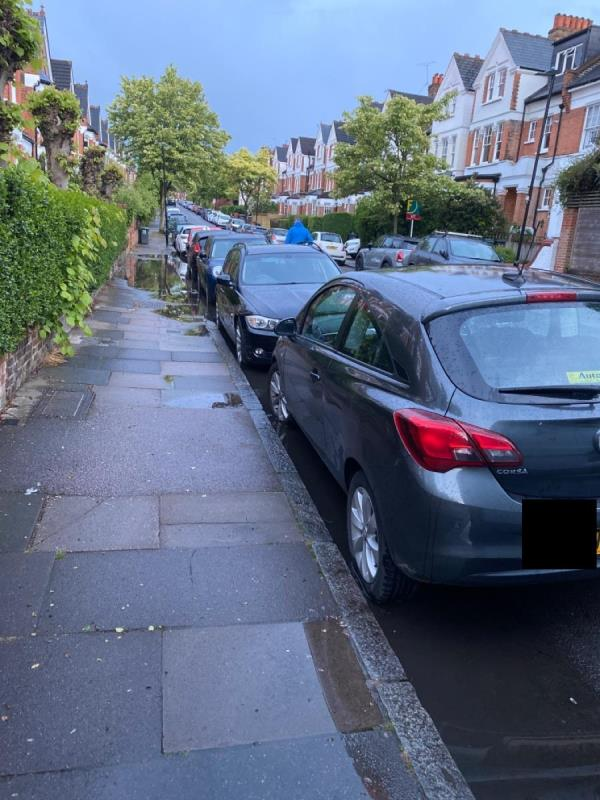 Flood stretching about 15 metres in gutter and overflowing onto pavement. I reported this a few months ago when it flooded previously -28 Muswell Avenue, Muswell Hill, N10 2EG