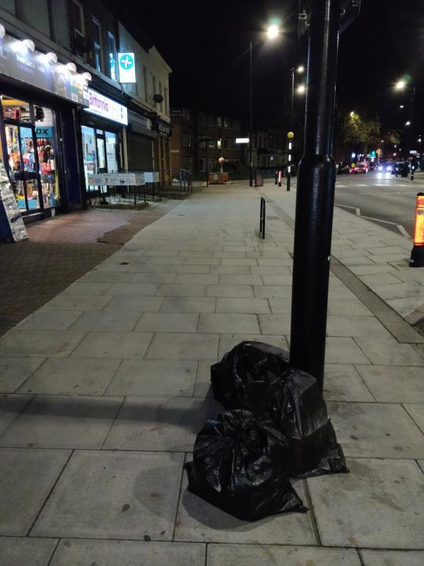 Dumped black bags of rubbish on the pavement beside 151 Leytonstone Road E15-151 Leytonstone Road, London, E15 1LH