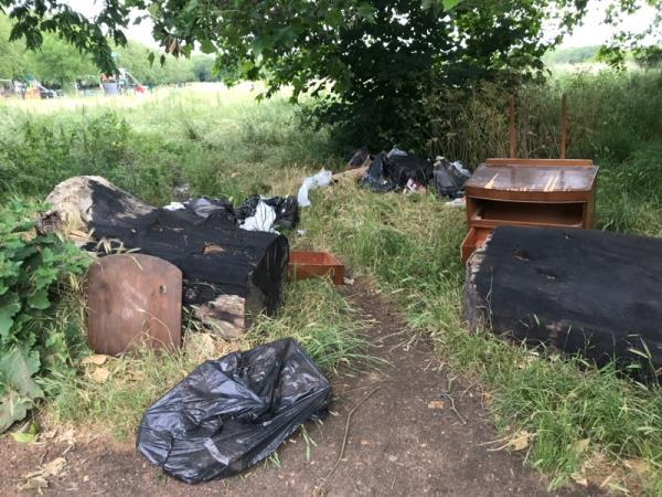 Fly tip and rubbish dumped in Wanstead flats on Sidney road just before corner with knighton -69 Sidney Rd, London E7 0ED, UK