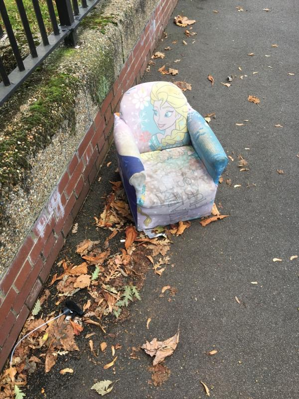Small child's chair dumped beside West Ham Park-123 Ham Park Road, London, E7 9LF