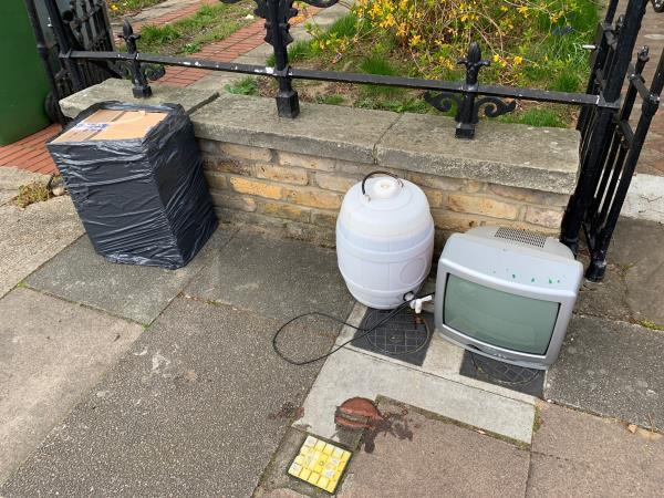 Fly tipped items on pavement including a plastic barrel with an unidentifiable liquid.-99b Osborne Road, London, E7 0PW