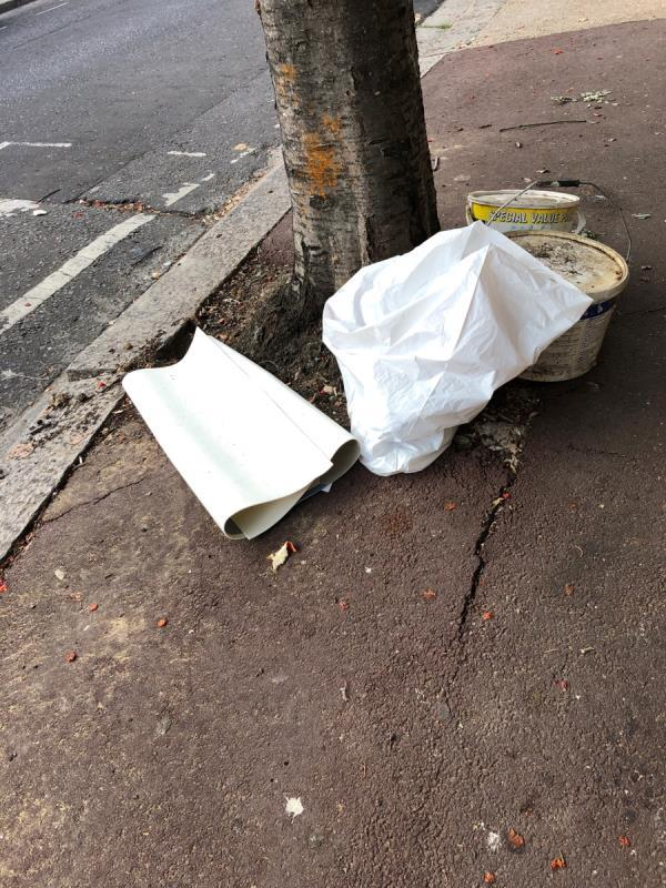 Piece of Lino, white bin bag, 2 x paint containers -49 Credon Rd, Plaistow, London E13 9BS, UK