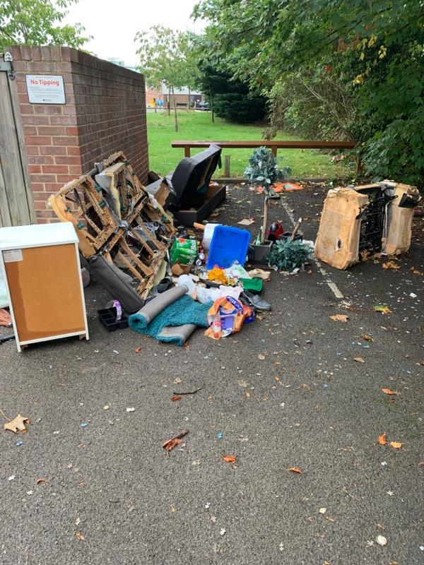 Flytipping in car park at Vincent house-Vincent House Great Knollys Street, Reading, RG1 7DA