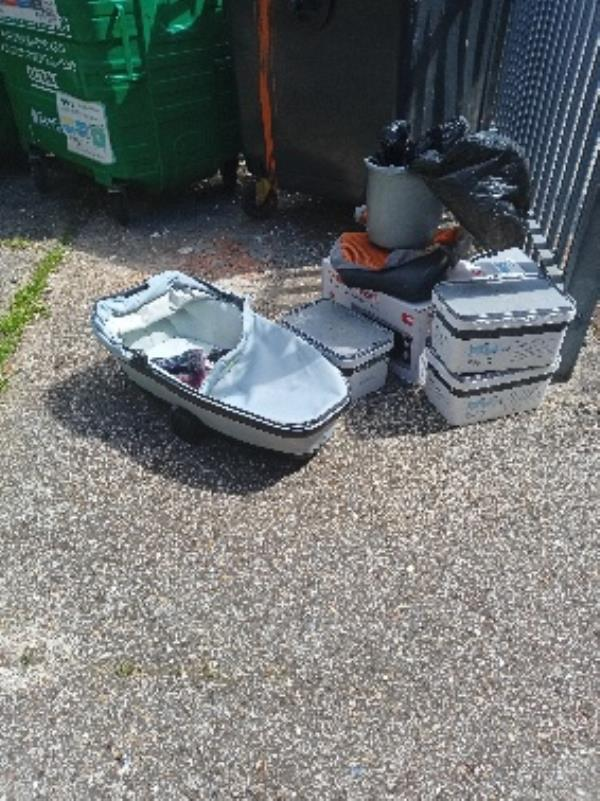 please remove fly tipping in bin store at 28 Granville road-28 Granville Road, Reading, RG30 3QE