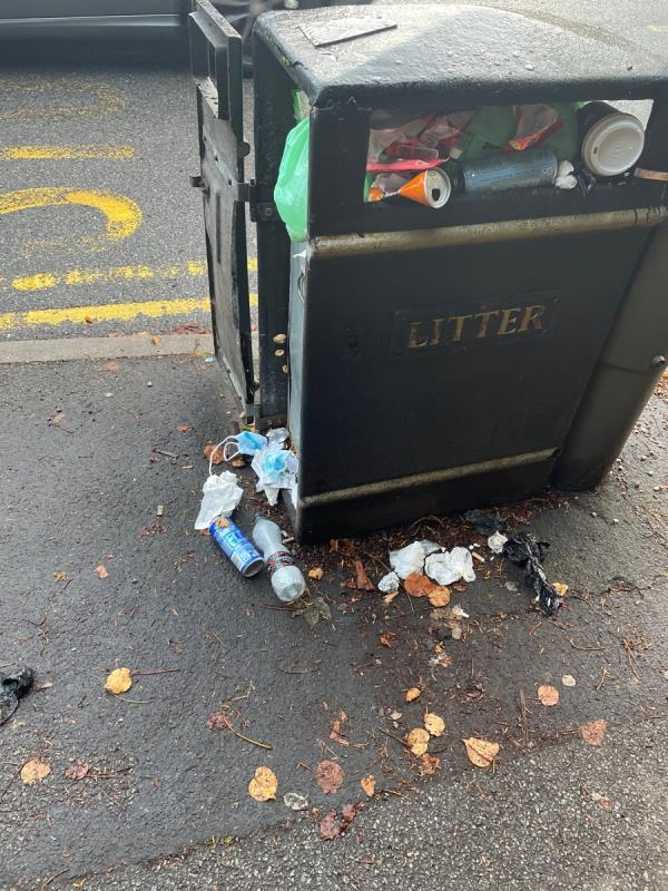 Opposite the hotel, the bin at Knighton road bus stop is over flowing and rubbish on the pavement -360 London Road, Leicester, LE2 2PL