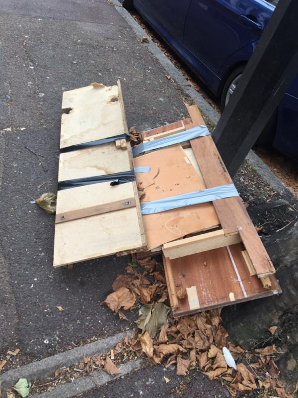 Broken furniture blocking the pavement as causing trip hazard -21 Creighton Ave, London E6, UK