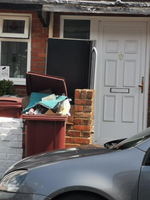 The recycling bin has been filled with non recycling materials so it hasn't been collected but its now a health hazard as the contents are beginning to rot. -130 Salisbury Road, Reading, RG30 1BN